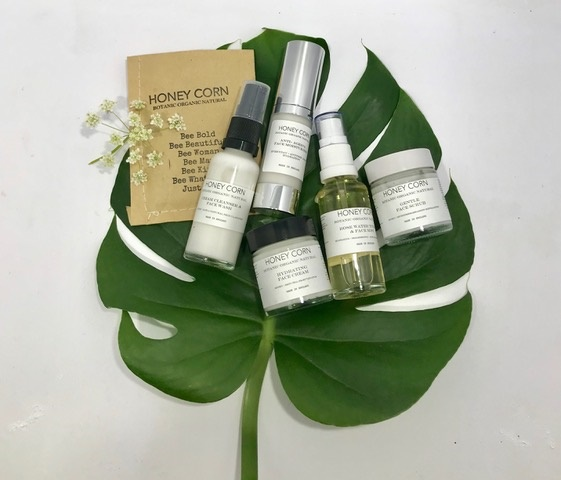Collection of Honey Corn skincare products.