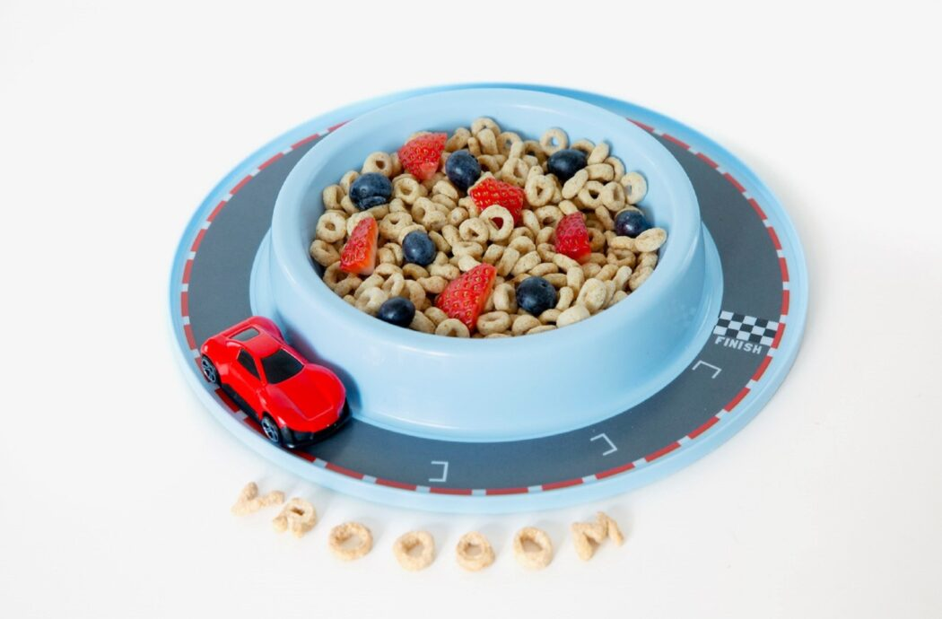 Munchy Play toy with built-in track for toy trains and cars to keep kids focused on their food.