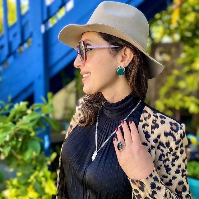 Model wearing jewellery from Ari D Norman.